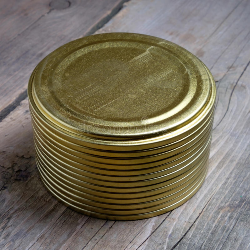Round cap. Round cover for cans which are used for pickling stock image