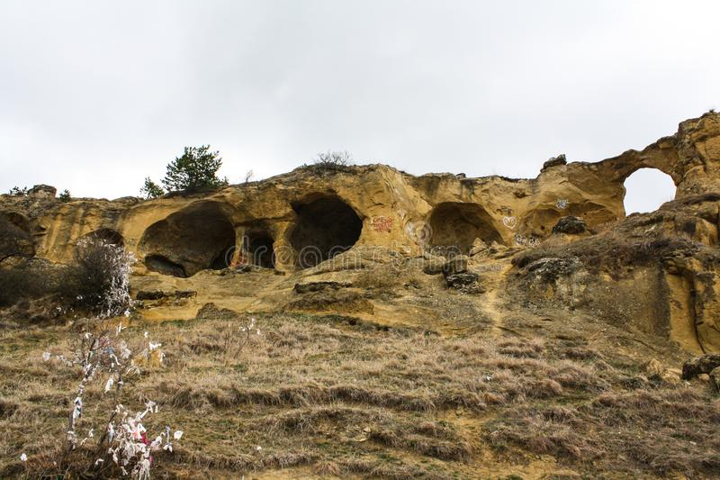 Round caves in the rock stock photography