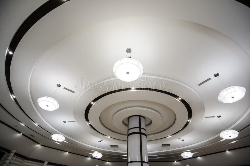 Round ceiling with modern white ceiling lights royalty free stock photography