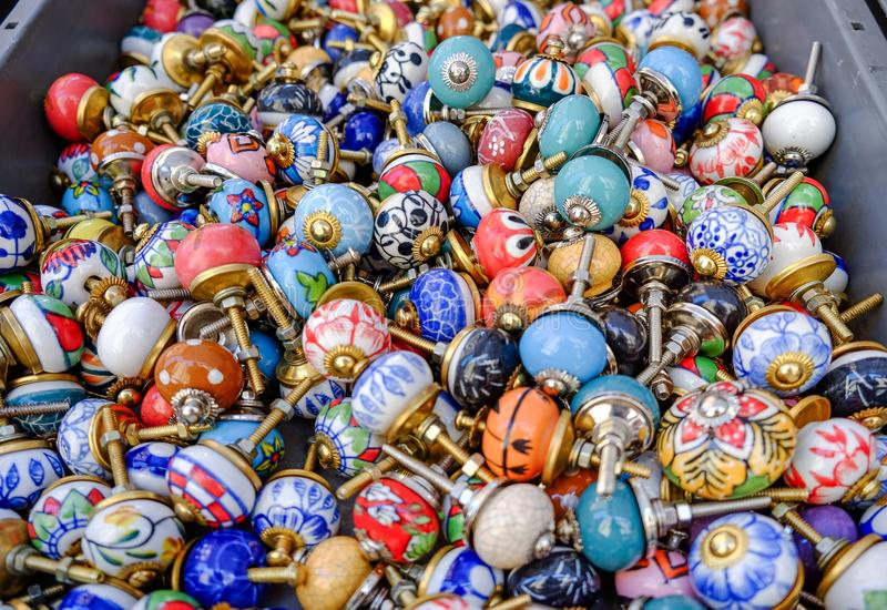 Round ceramic furniture handles for doors or kitchen cabinets sold at local market royalty free stock photos