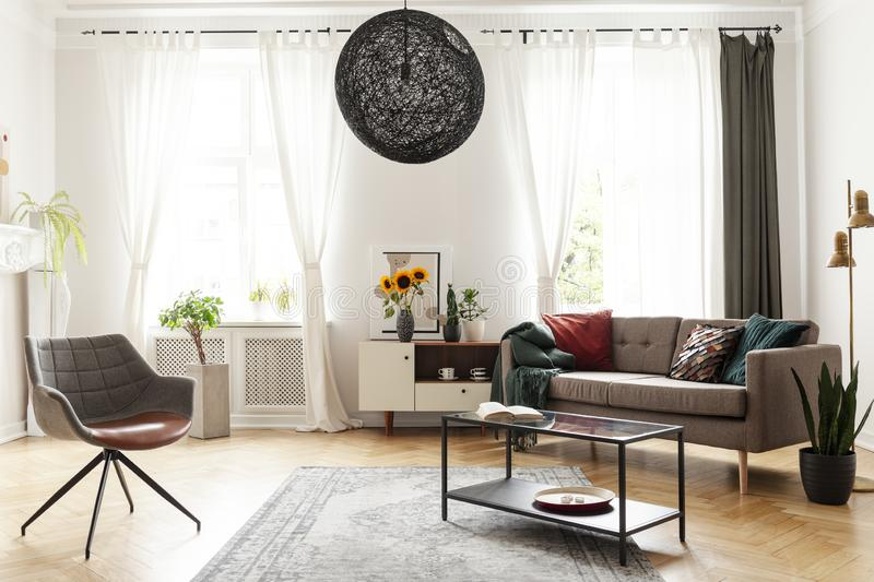 Round chandelier in a retro living room interior royalty free stock photography