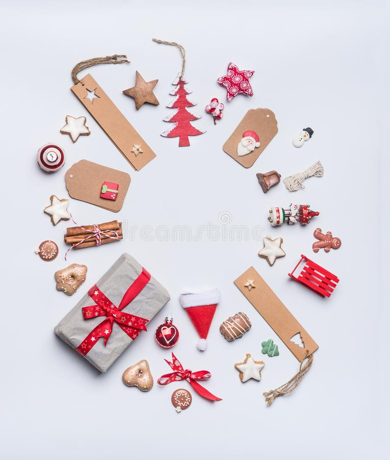 Round Christmas frame layout composition for greeting card with craft paper , tags and gifts royalty free stock photos