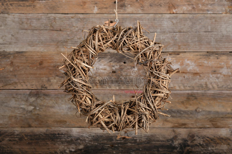Round Christmas Wreath Natural Twigs on Old Rustic Background. Round brown christmas wreath from natural twigs on old wooden rustic background stock photos