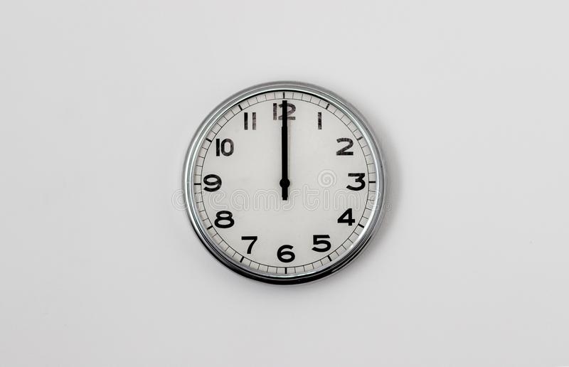 Clock 12:00. Round clock face displaying 12 O` clock stock photography