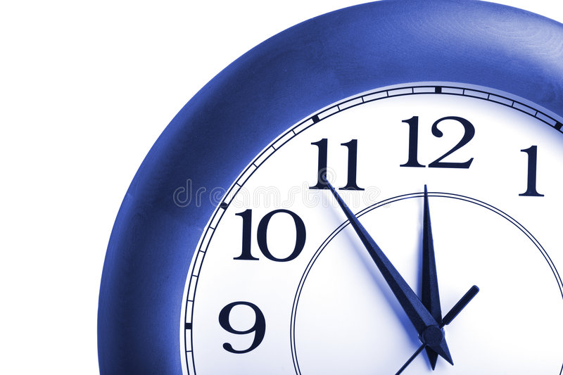 Round clock showing time about twelve isolated royalty free stock photos