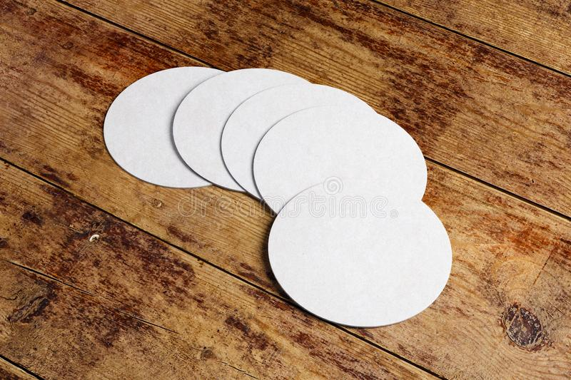 Round coaster on wooden counter. Top view and close up of round beer coaster on wooden counter. Mock up, 3D Rendering vector illustration