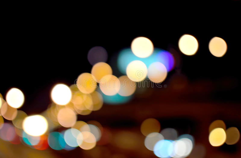 Round colored bokeh shots taken from the car lights at night. stock photography