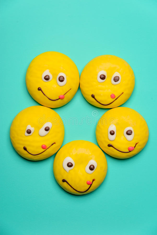 Round cookie with smiling face stock images