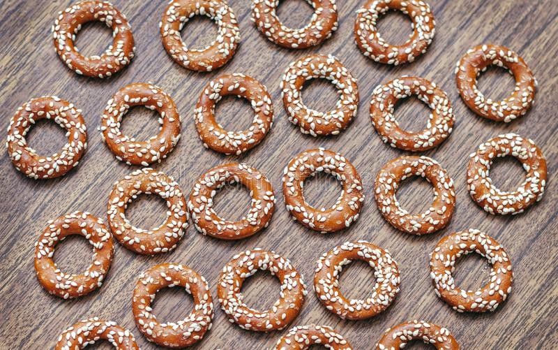 Round cookies with sesame seeds on the wooden background royalty free stock photos