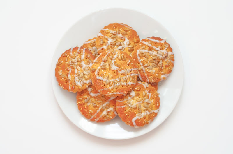 Round cookies with sunflower and sesame seeds, top view, small d stock photo