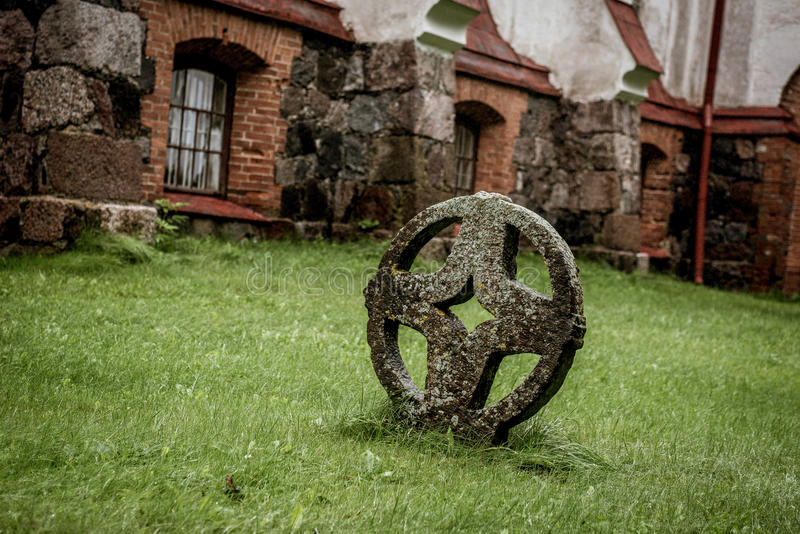 Round cross in front of church royalty free stock photo