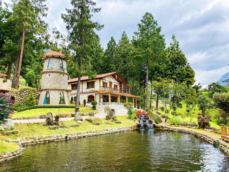 Rustic Countryside Restaurant sits on a Pond in El Cajas Mountains stock photography