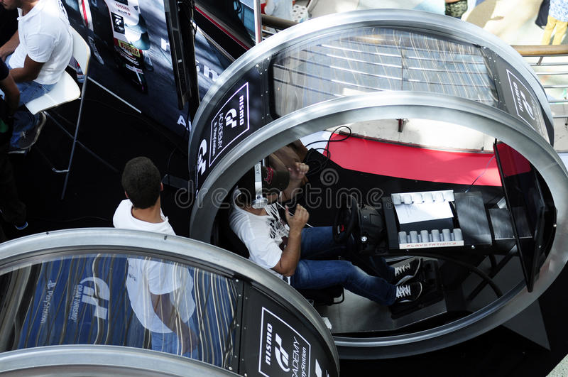 Round Driving Simulator - GT Academy, PlayStation. Modern driving simulator for PS4. In July 2014, PlayStation Portugal and GT Academy again launched the royalty free stock photos
