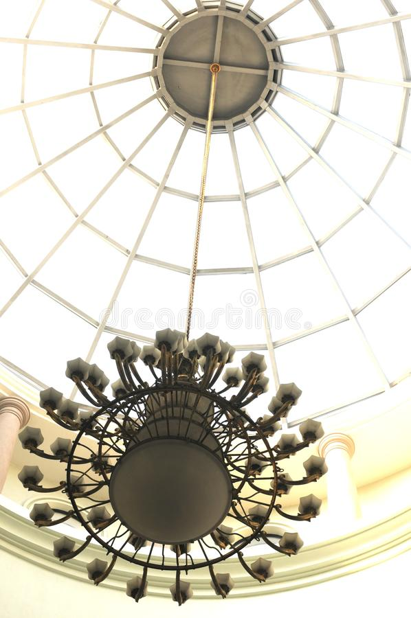 Download A Round Drop Light With A Golden Chain Hanging On A Glass Dome Stock Photo - Image: 29889838
