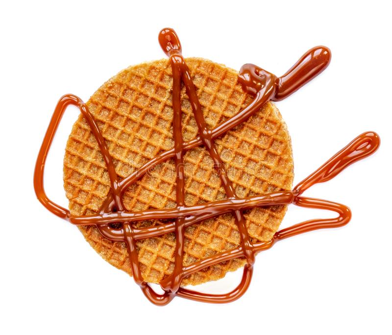 Round Dutch waffle with caramel sauce  isolated on white background. Top view.  stock photo