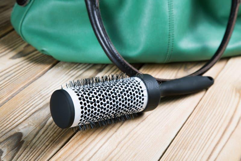 Round female comb with a handbag. Round female comb close up with a handbag stock photos