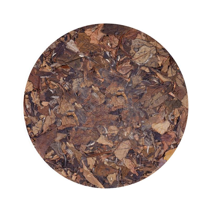 Round flat disc of puer tea isolated on white background. Chinese tea Puer. Pressed fermented Pu-erh tea. Macro close up. Aromatic green puer tea. Healthy royalty free stock photos