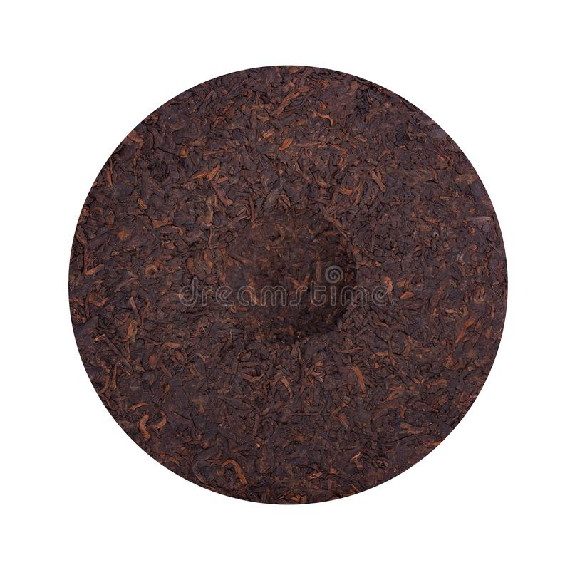 Round flat disc of puer tea isolated on white background. Chinese tea Shou Puer. Pressed fermented Pu-erh tea. Macro. Close up. Aromatic black puer tea. Healthy royalty free stock photos