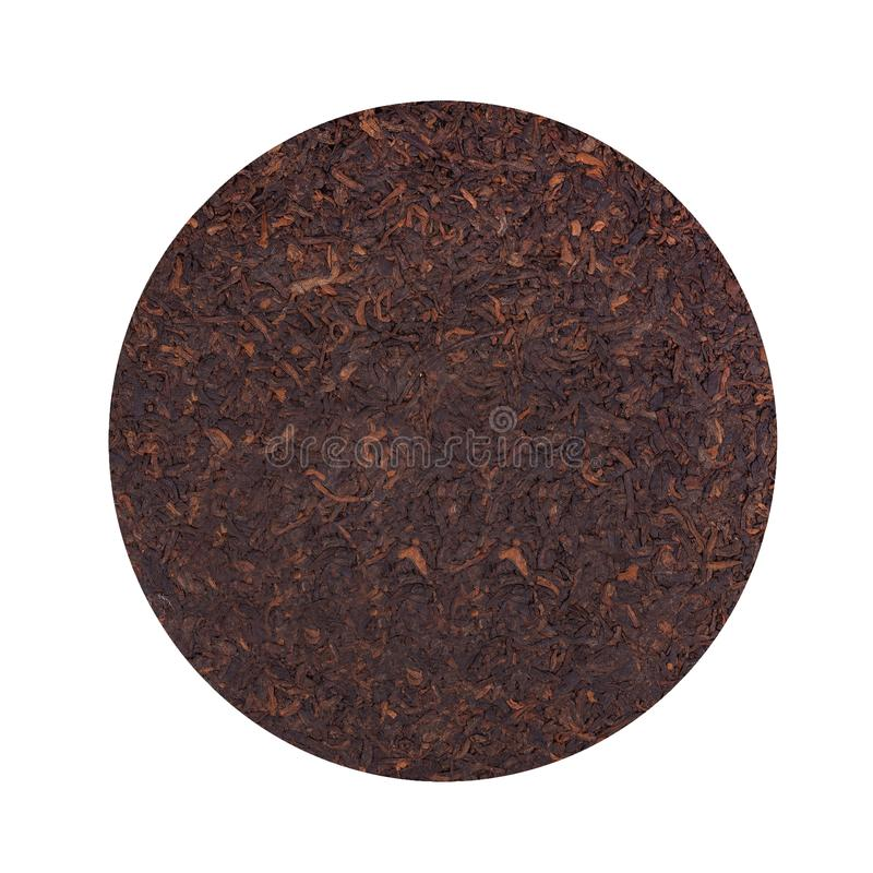 Round flat disc of puer tea isolated on white background. Chinese tea Shou Puer. Pressed fermented Pu-erh tea. Macro. Close up. Aromatic black puer tea. Healthy stock image