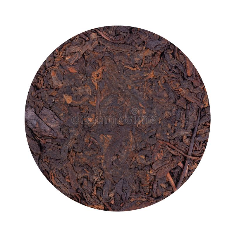 Round flat disc of puer tea isolated on white background. Chinese tea Shou Puer. Pressed fermented Pu-erh tea. Macro. Close up. Aromatic black puer tea. Healthy royalty free stock photography