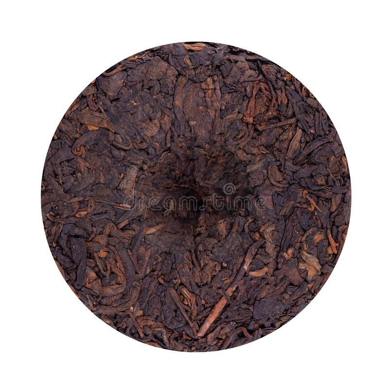 Round flat disc of puer tea isolated on white background. Chinese tea Shou Puer. Pressed fermented Pu-erh tea. Macro. Close up. Aromatic black puer tea. Healthy royalty free stock photo