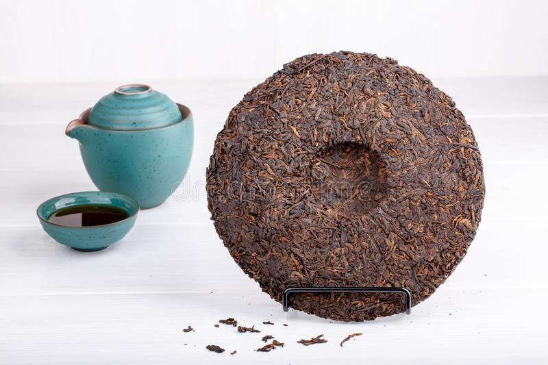 Round flat disc of puer tea on white royalty free stock photo