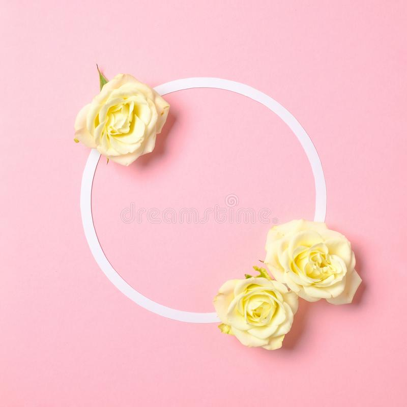 Round floral frame with roses flowers petals on pastel pink background. Top view, tender minimal flat lay style composition. royalty free stock images