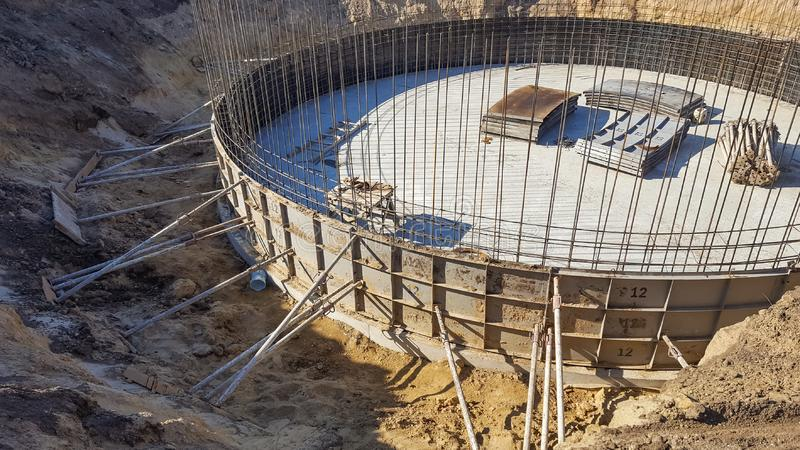 Round the foundation with the rebar in the early construction. stock photo