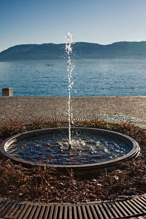 Round fountain with water gush, on the shore of Lake Maggiore in. Italy stock photos