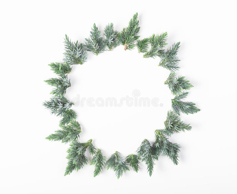 Round frame made of juniper branches isolated on white background. Flat lay. Christmas or New year compo stock images
