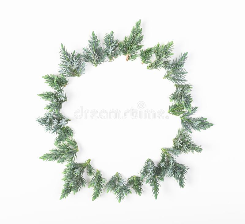 Round frame made of juniper branches isolated on white background. Top view. Flat lay. Christmas or New year composition. Round frame made of juniper branches stock photo