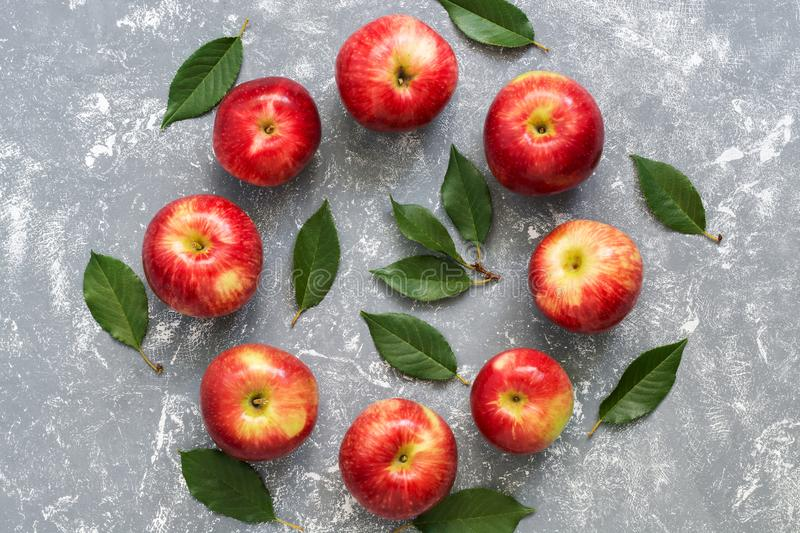 Round frame of red apples and leaves. Creative composition. View from above, flat lay stock photography