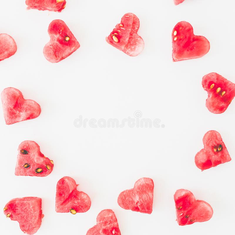 Round frame of watermelon pattern on white background. Valentine`s day pattern concept. Flat lay, top view royalty free stock photography