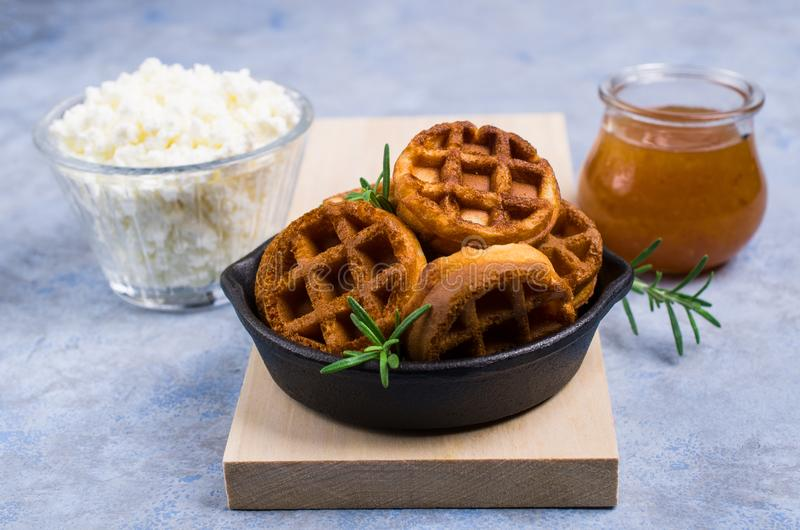Round fried waffles. With jam and curd cheese. Selective focus stock image
