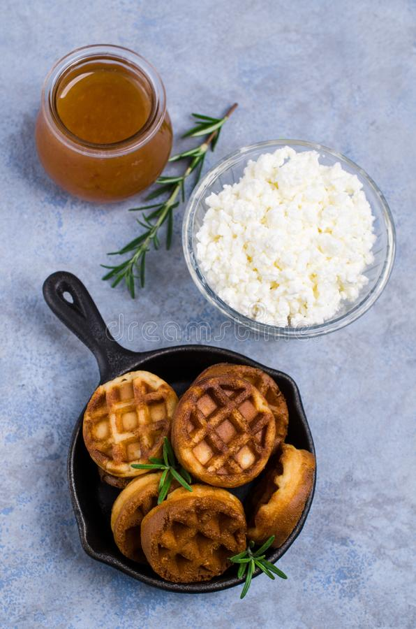 Round fried waffles. With jam and curd cheese. Selective focus royalty free stock images