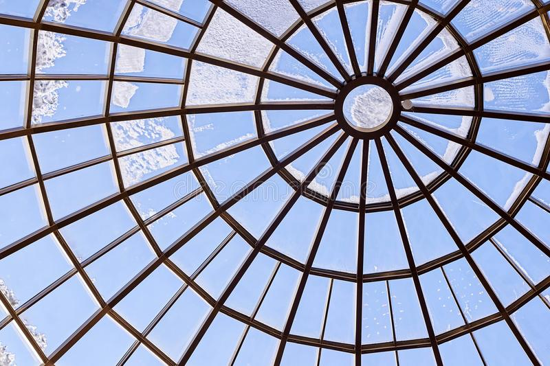 Round glass roof. Modern architecture. Blue color stock image