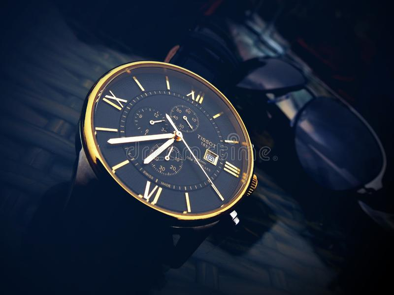 Round Gold-color Chronograph Watch With Black Strap at 7:36 royalty free stock images