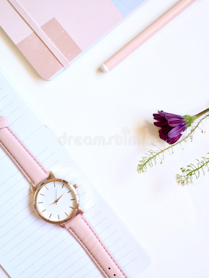 Round Gold-colored Analog Watch at 2:46 on Top of White Paper royalty free stock photos