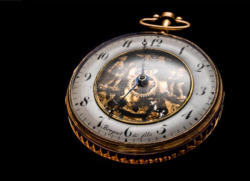 Round Gold-colored Pocket Watch royalty free stock image