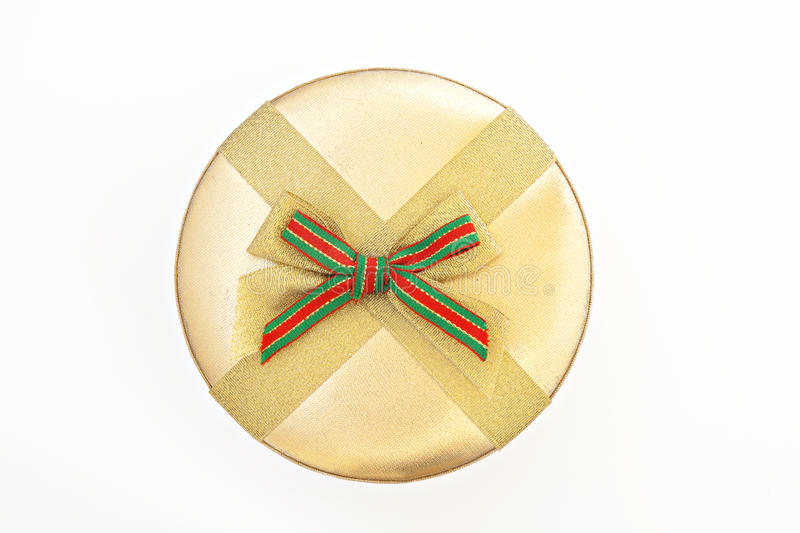 Round golden gift box with ribbon and bow isolated.  royalty free stock photos