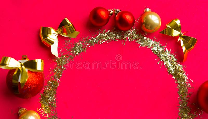 Round golden tinsel frame on red background. stock photos