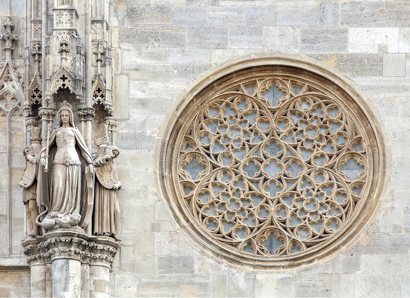 Round gothic window on the facade of the St. Stephen`s cathedral, Vienna. Austria stock images