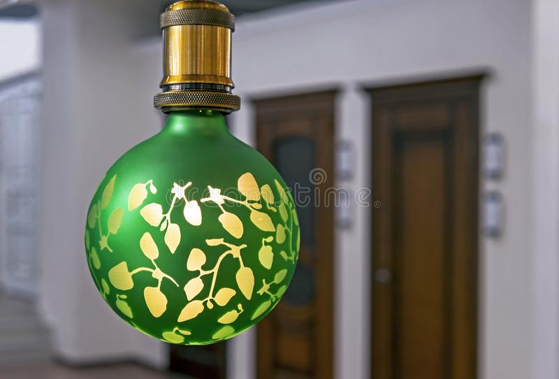 Round green lamp with frosted glass and yellow pattern stock photography