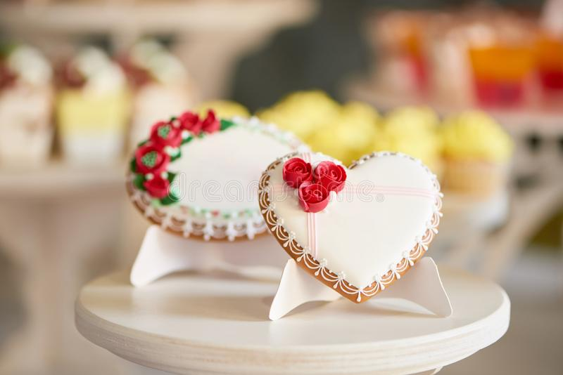 Round and heart shaped glazed cookies stock photography