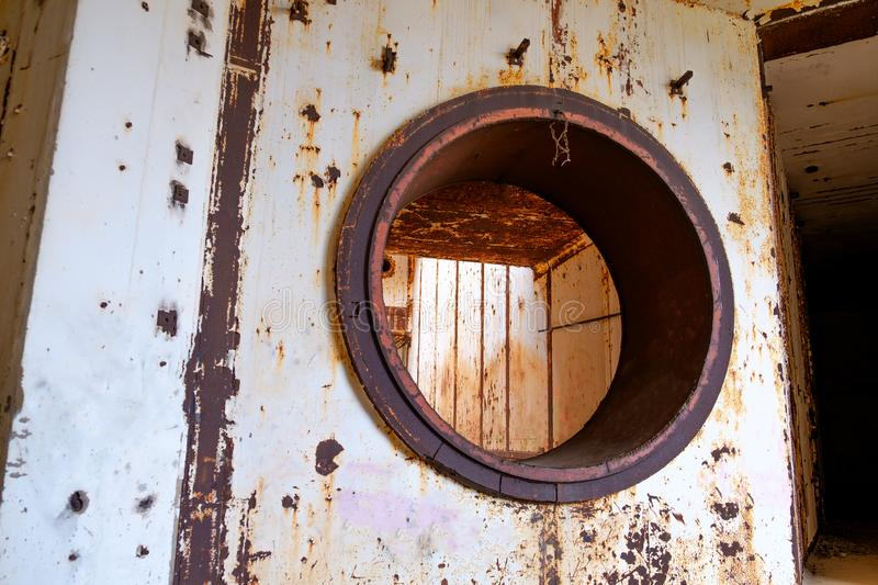 Round hole in the wall covered by rust stock photo