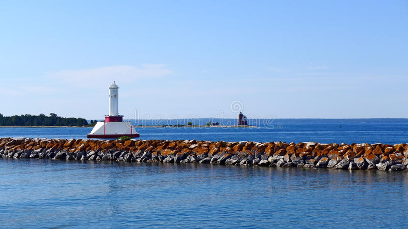 Round Island Lighthouse. Old Round Island Point Lighthouse and Passage Light in Straits of Mackinac Michigan royalty free stock image