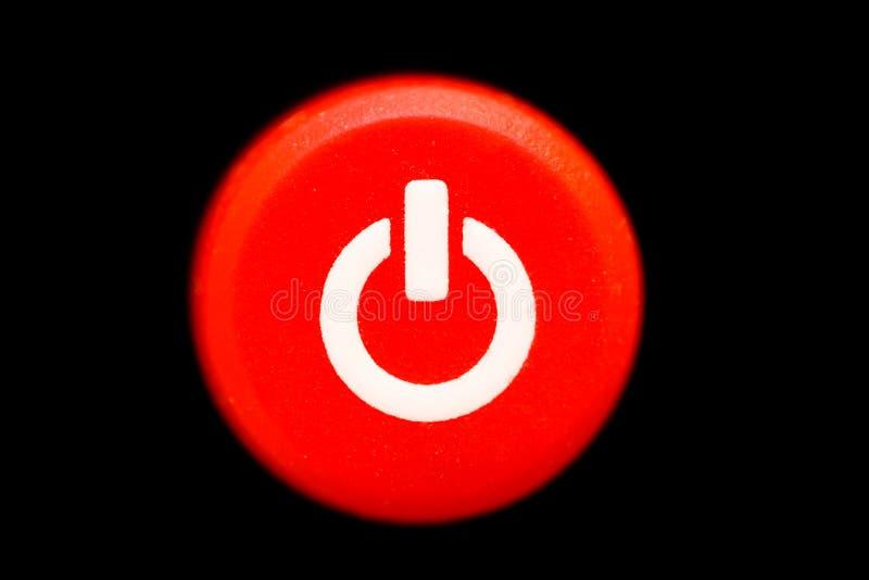 Round jaskrawej czerwonej władzy z przerwami guzik lub zmiana z białego władza symbolu makro- fotografią fotografia stock