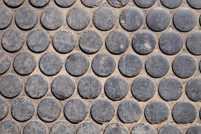 Round kształt, mozaik płytki kształtuje, ciemny brzmienie, tekstura z czarnym plombowaniem jako t?o dla projekta zdjęcie stock