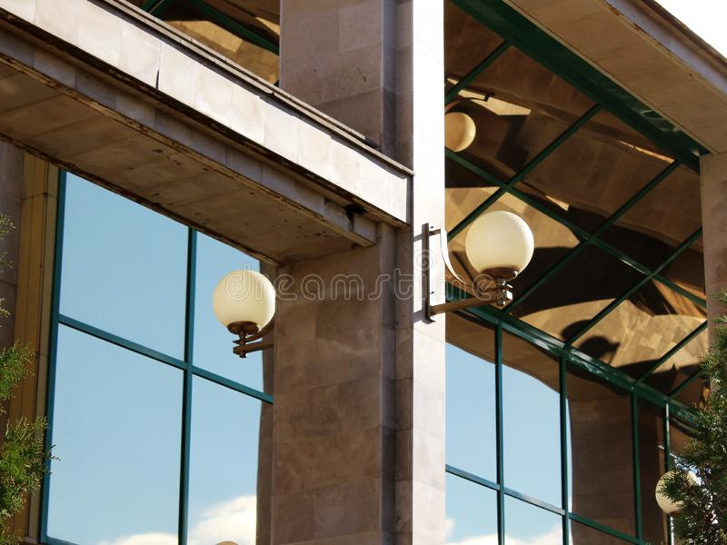 Round lights on the glass facade of the building. Object stock image