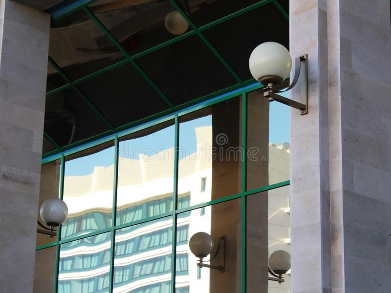 Round lights on the glass facade of the building. Object royalty free stock photos